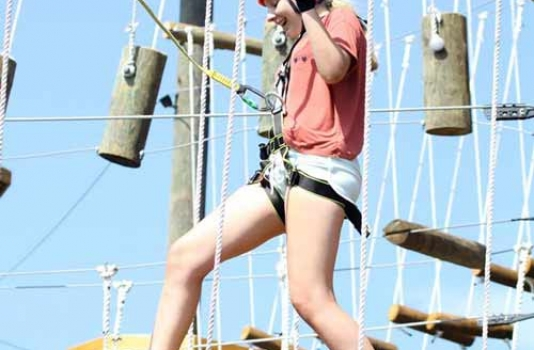 Corolla Adventure Park climber having fun