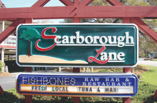 OBX VACATION FUN GUIDE - Photo of exterior sign at Scarborough Lane Shoppe